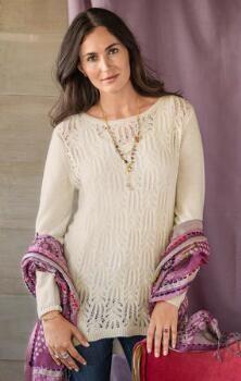 Glamour y femenino, este marfil suéter pointelle túnica le da un suave elegancia a su estilo distintivo.