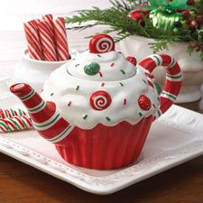 """Christmas Cupcake Teapot/Sweeten the holidays for a tea drinker with this festive cupcake-shaped teapot. Fanciful red, white, and green ceramic design is about 5 1/2"""" H. Hand wash. $12.99"""