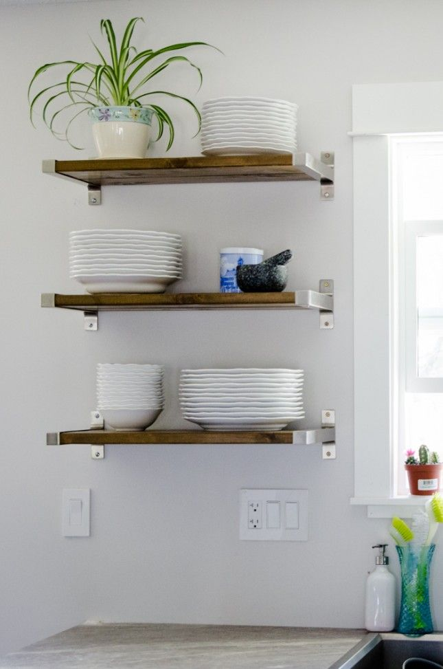 open shelving we re loving open shelving in the kitchen and are rh pinterest com kitchen wall shelves wood kitchen wall shelves for dishes