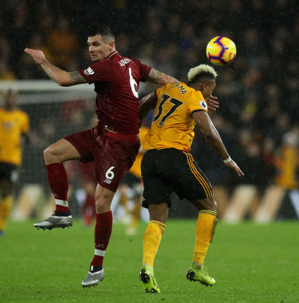 Dejan Lovren Of Liverpool Is Challenged By Adama Traore During The Dejan Lovren Liverpool Premier League Matches