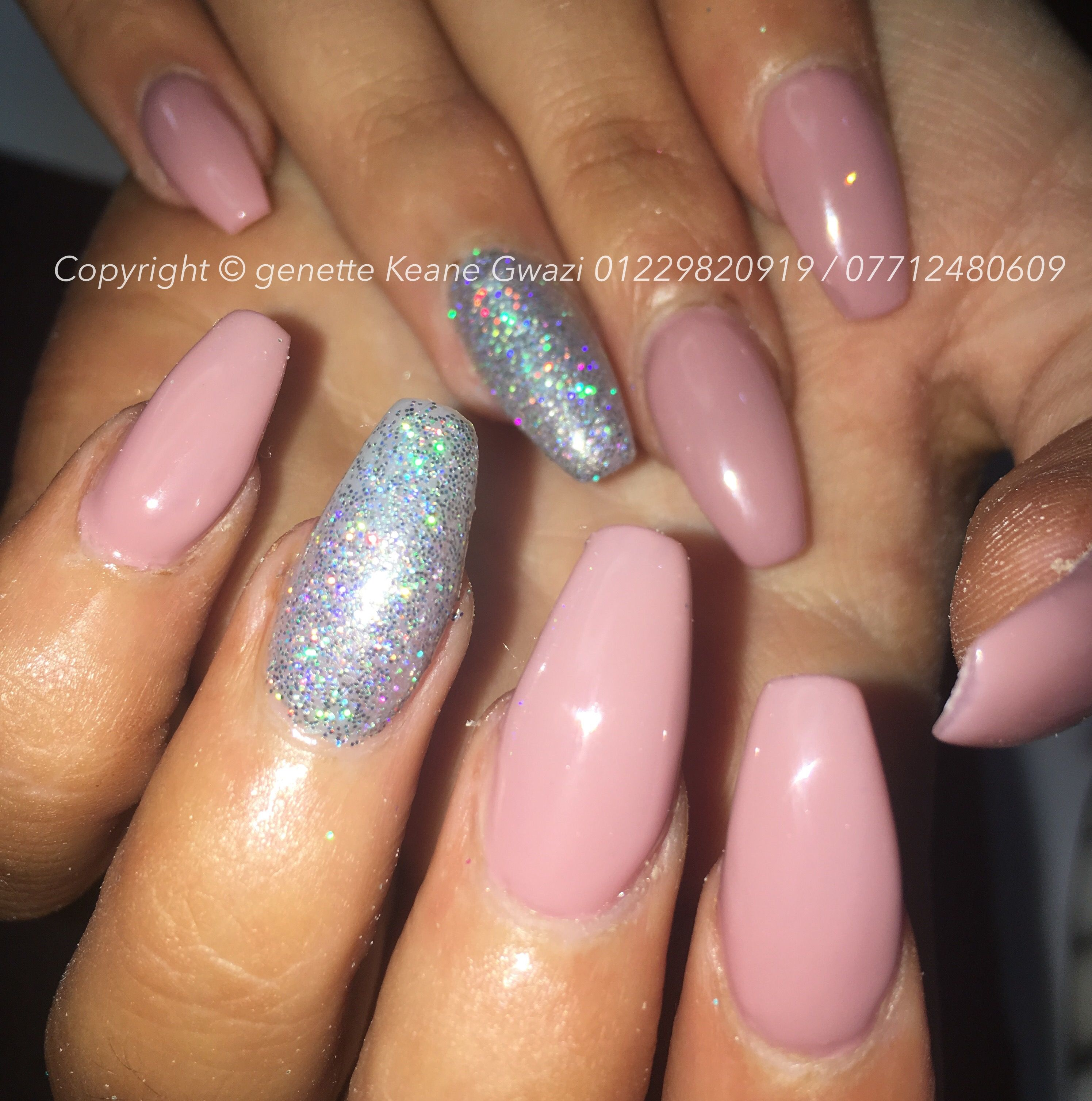 nude pink coffin acrylic nails with silver holographic magpie