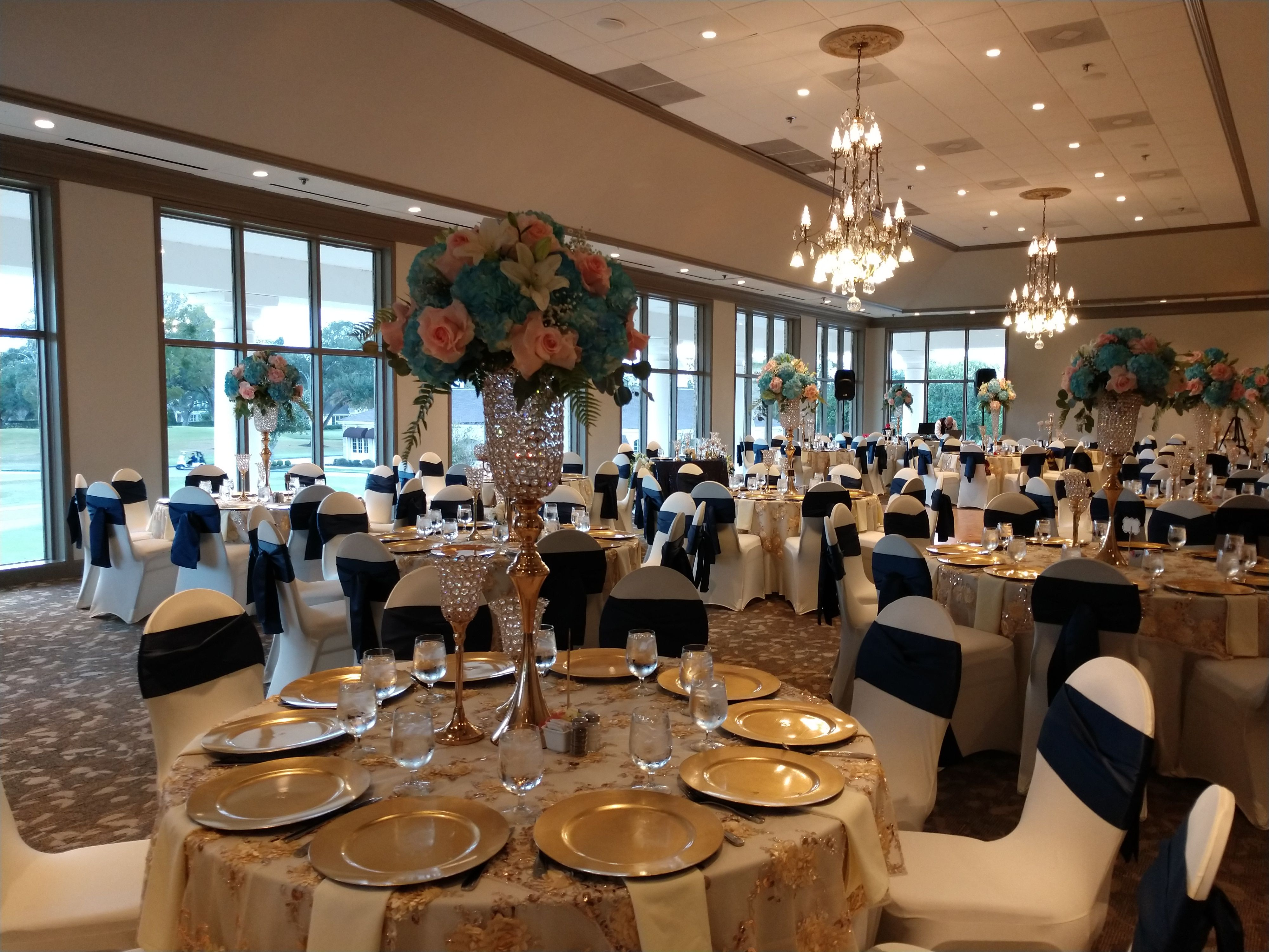 Superieur Wedding Reception With Ivory Chair Covers, Navy Blue Chair Sashes, Gold  Charger Plates, And Tall Gold Centerpieces In The Ballroom At Sugar Creek  Country ...