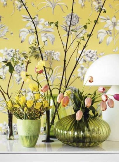 light gray and yellow wallpaper with flowers are wall decorating ...