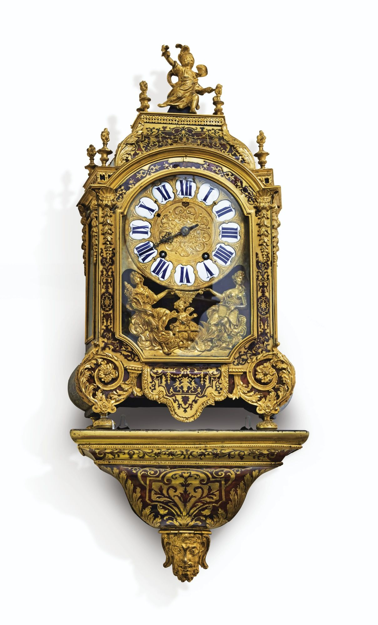 Date Unspecified A GILT BRONZE RED TORTOISESHELL AND BRASS MARQUETRY CARTEL CLOCK CONSOLE LOUIS XIV THE MOVEMENT