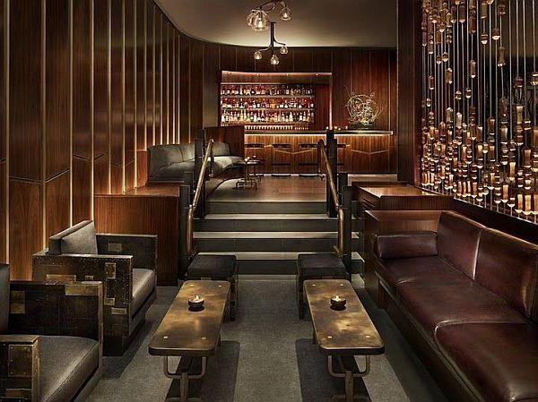 this steampunk designed lounge marries the warmth in the wood leather tones with the cool steel copper touches
