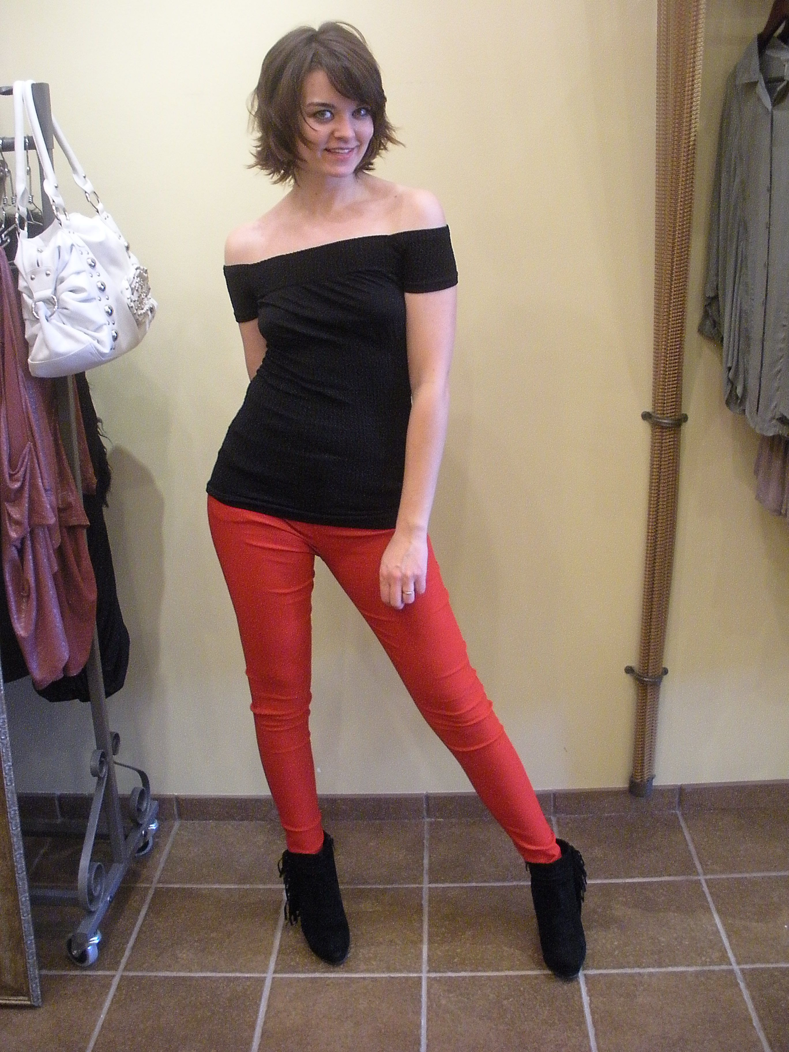 Off Shoulder Top, Red Skinny Pants, and Fringe Booties all available at Sassen Boutique and Hair Salon!