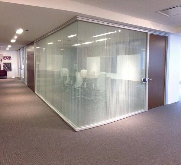 Optos low profile is a glass wall system featuring a rectilinear profile and minimal structure Interior glass partition systems