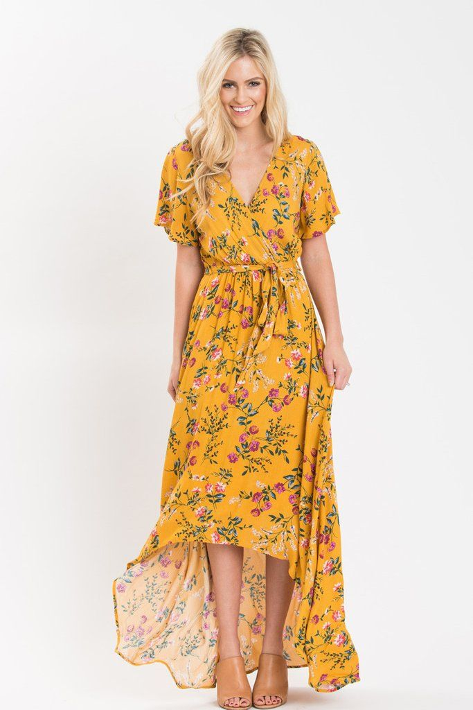774a1b604ba4 We love floral dresses and this yellow high-low maxi dress is no exception!  The gorgeous mustard color, faux-wrap front and.