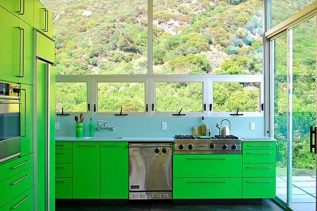 """This is the Beauvoir House, located in Las Flores Canyon in Malibu,"" says Bruce Bolander, known for his colorful kitchens. ""The color was influenced by the color of the new growth on the chaparral that surrounds the house. The house and kitchen are both very small; the house is about 1600 square feet."""