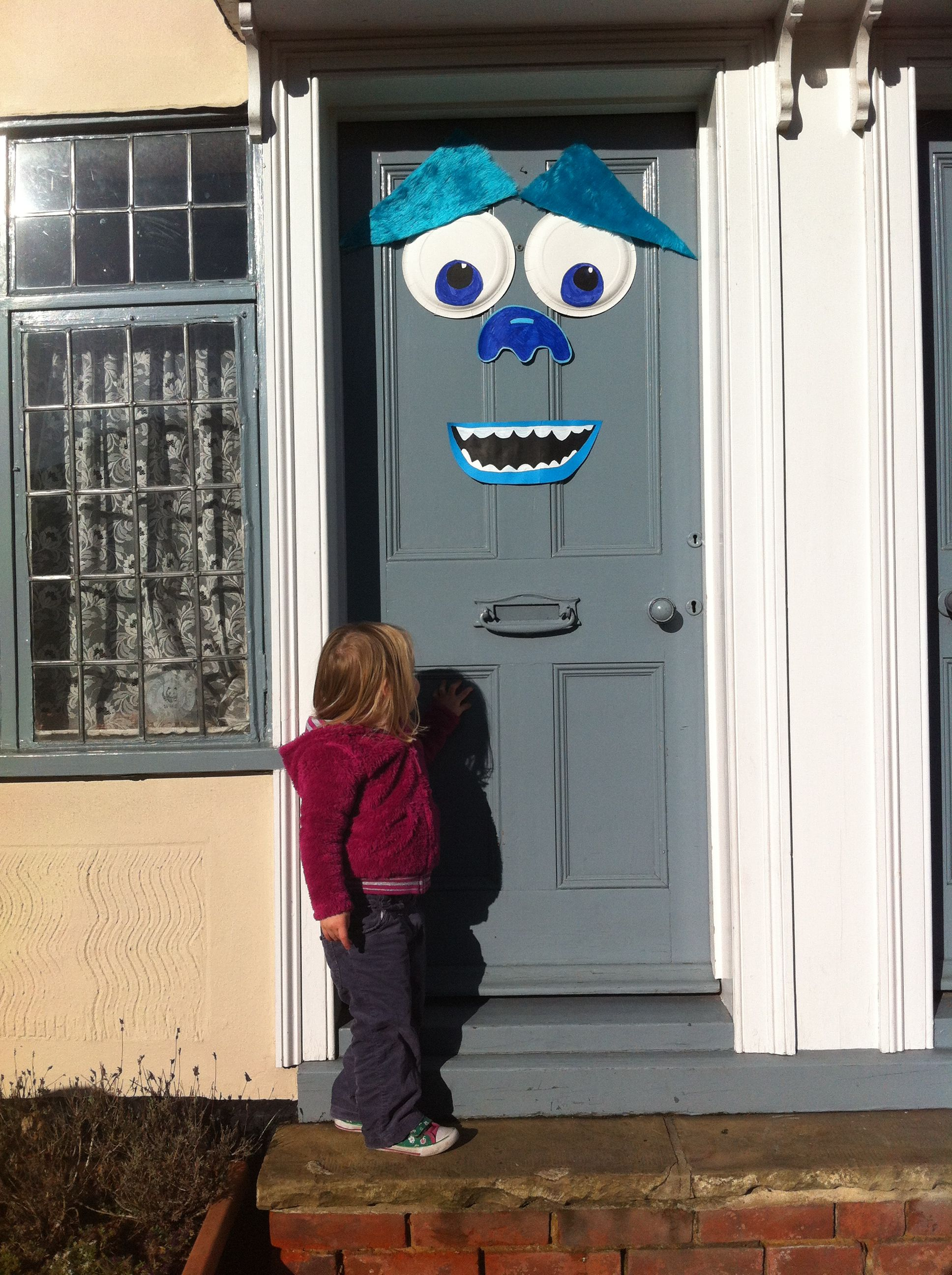 a sully front door decoration my monster door for halloween its sully from monsters incmonsters university he has paper plates for the eyes and fun fur