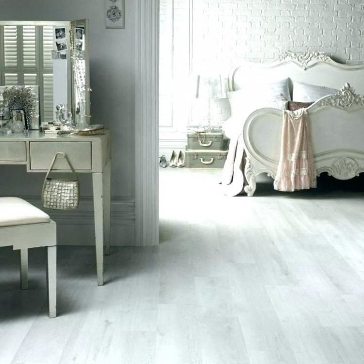 This Lovely White Laminate Floor Looks Just Like Freshly Fallen Snow White Oak Laminate Flooring White Laminate Flooring White Wood Floors