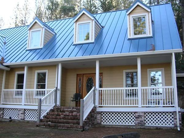 Blue metal roof pictures google search the blue for Images of houses with metal roofs