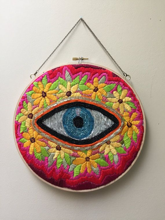 Beaded evil eye with flowers by TessaPerlowInc on Etsy