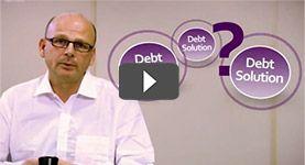 Still from the Debt remedy video