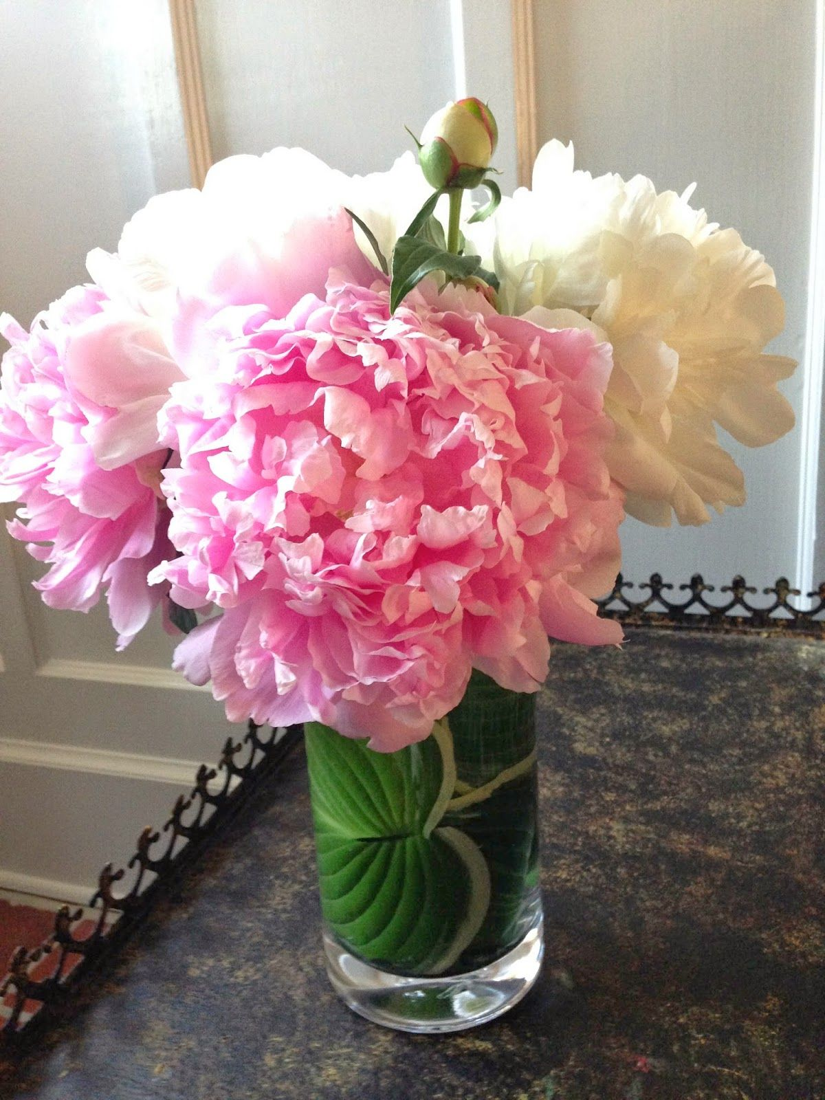 Floral design how to line a clear vase like a pro florals i line these hanging vases in my sunroom with a strip of cast iron leaf and add one statement flower peonies are perfect as are gerbera daisies and izmirmasajfo