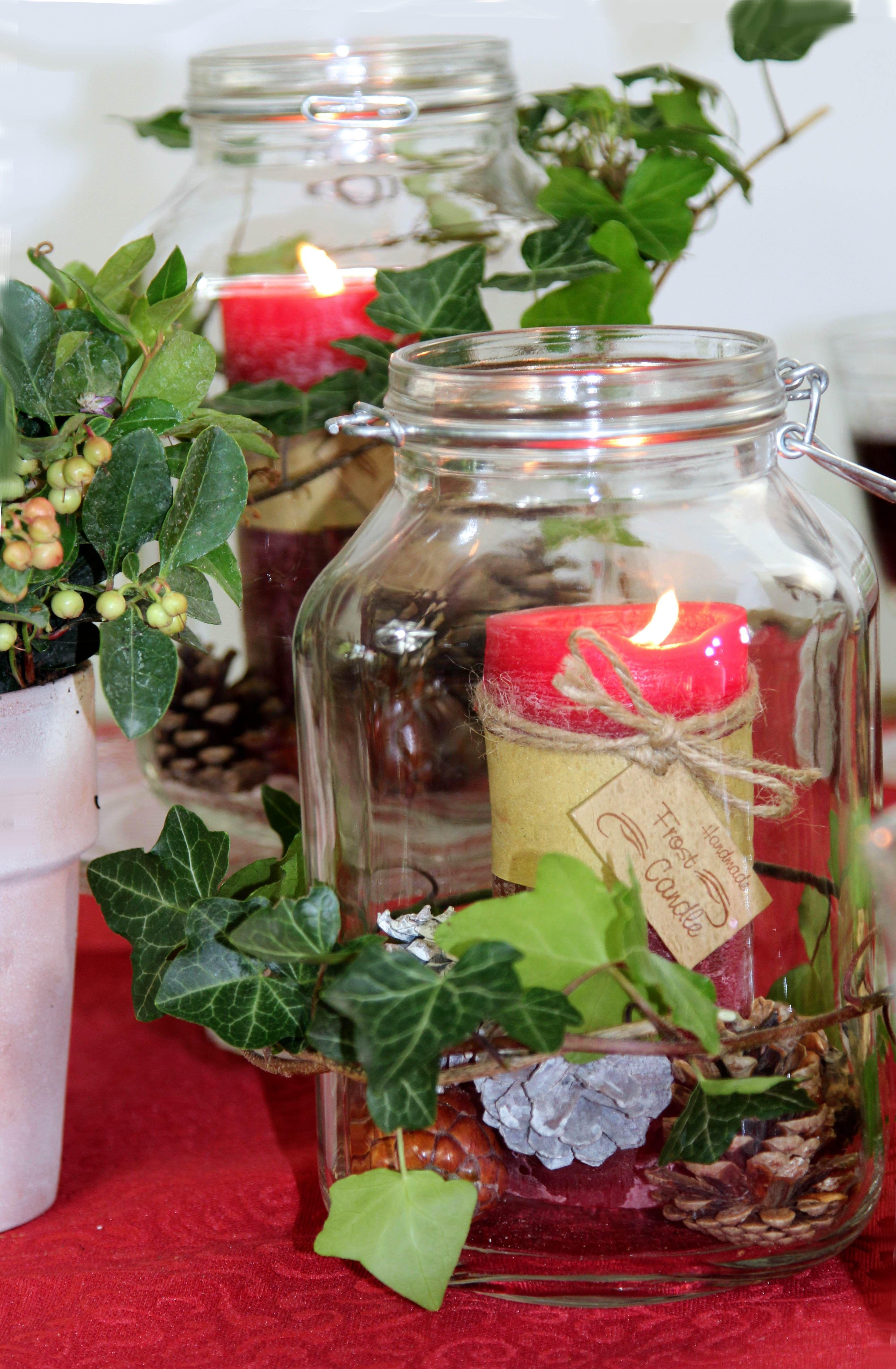 Dekorierte weckgl ser als windlichter tischdecke sander for Herbst dekoration im glas
