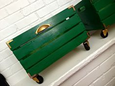plain wood crates from Michael's upgraded with paint, casters, l brackets, and drawer pulls. Much prettier for storing things. (Houseologie)