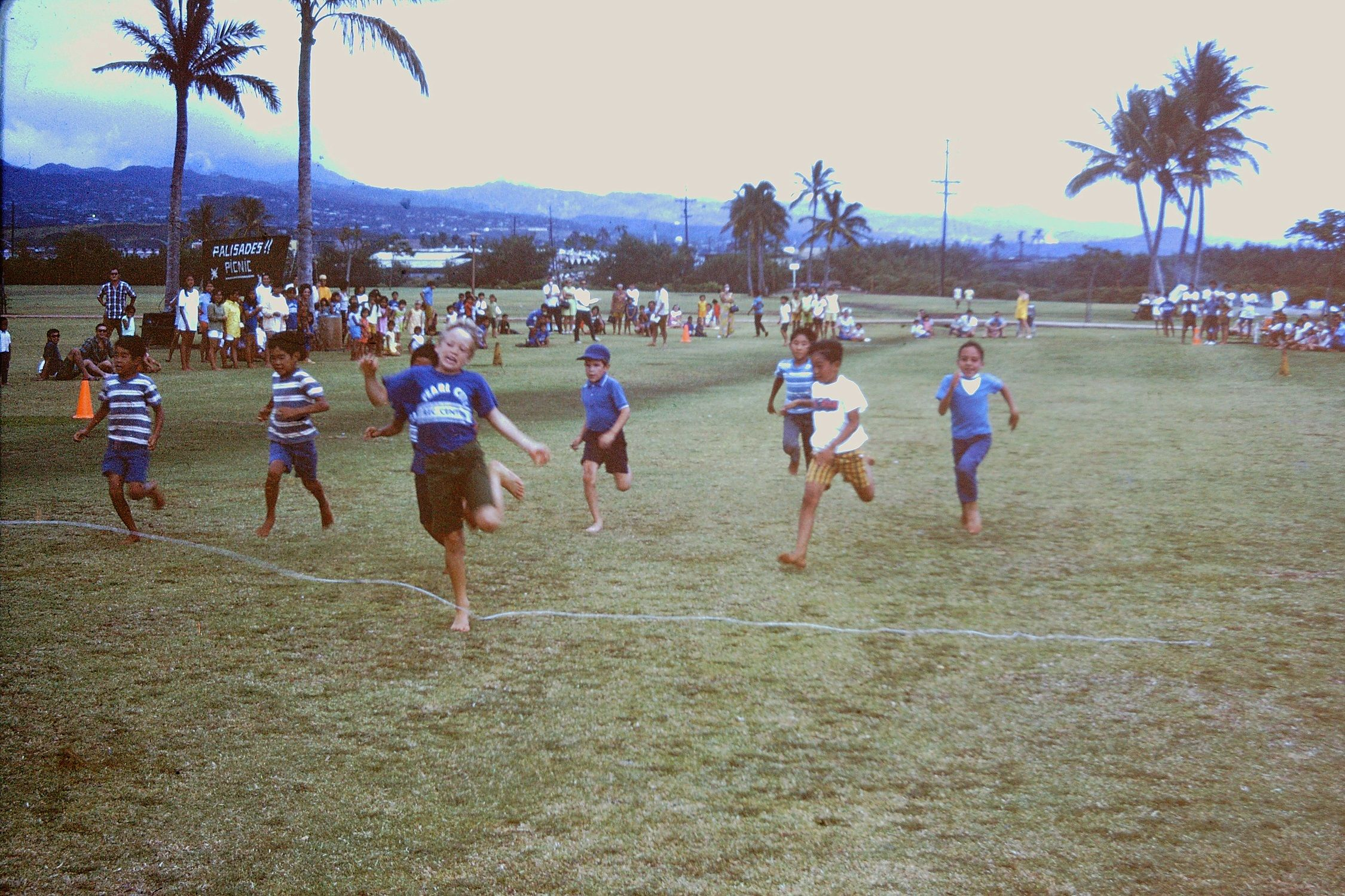 Back in 1969 summer several families from Palisades had this summer get together in Pearl Harbor Park (now Blaisdell). Here I am in a race. My friend Mark Hill won.