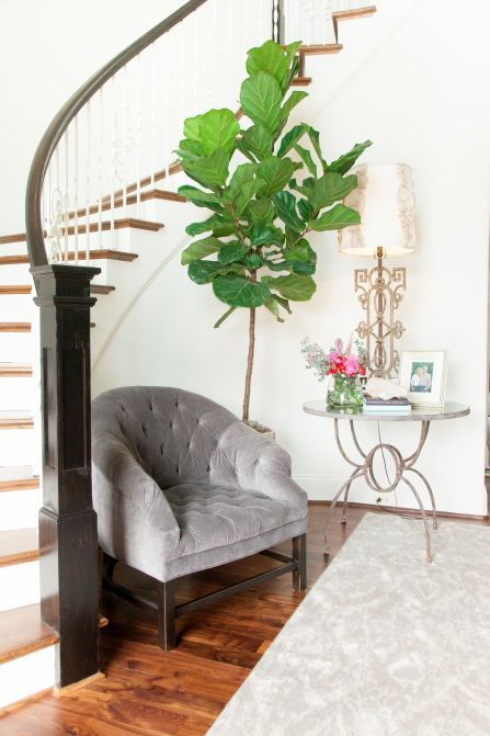 Foyer Boasts A Curved Staircase Nook Filled With A Gray