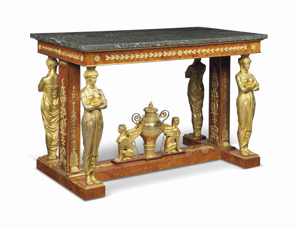 A FRENCH ORMOLU-MOUNTED AMBOYNA CENTRE TABLE  MID-20TH CENTURY, AFTER THE MODEL BY JACOB-DESMALTER