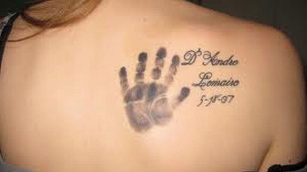 Baby S Hand Print Tattoo Baby Hand Tattoo Hand Print Tattoos Baby Tattoos