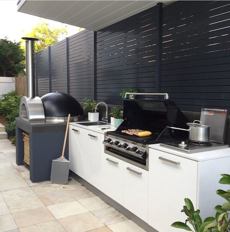 Outdoor kitchen with pizza oven, outdoor room, landscape ...