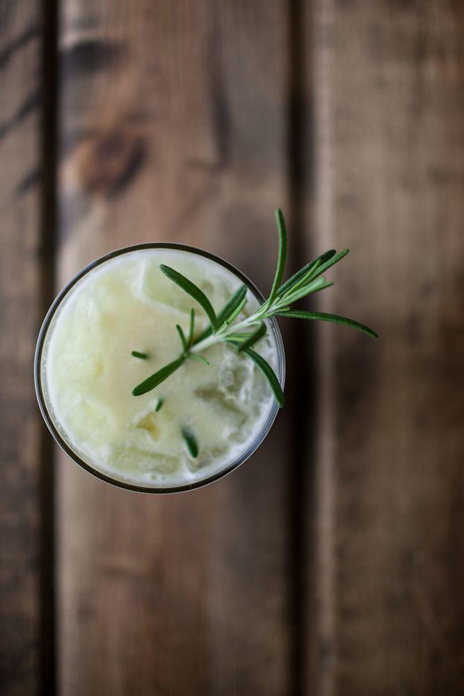 Apple, Pear and Gin Cocktail - Pears, Green Apple, Gin, Honey, Lemon Juice, Club Soda, Rosemary Sprig.