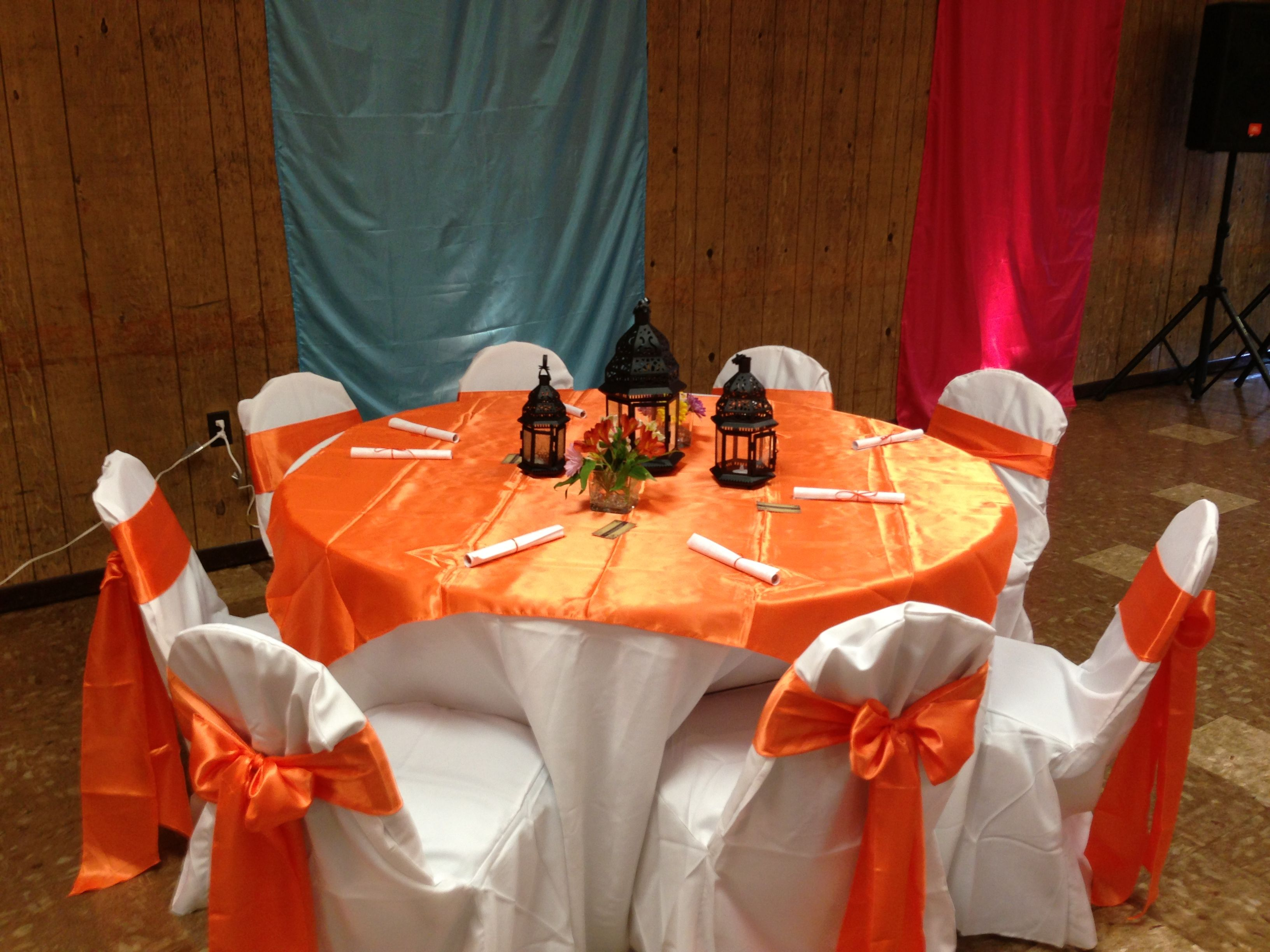 Guest Table With Morrocan Lamps Centerpieces And Flowers (Orange)