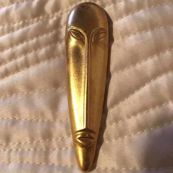 Great looking pin Gold pin.  Very pretty!  Has some weight to it though.  Looks great on a coat, sweater or jacket. Other