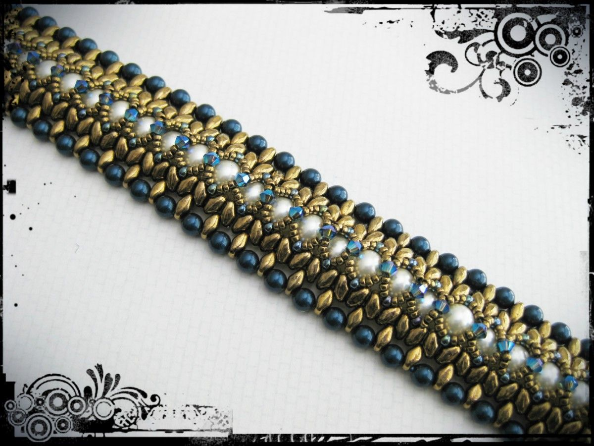 Cool blues and deep bronzes offset by glorious creams make this bracelet a stunner for any occasion. Swarovski pearls, superduos and Swarovski crystals make this sumptuous piece an essential part ...