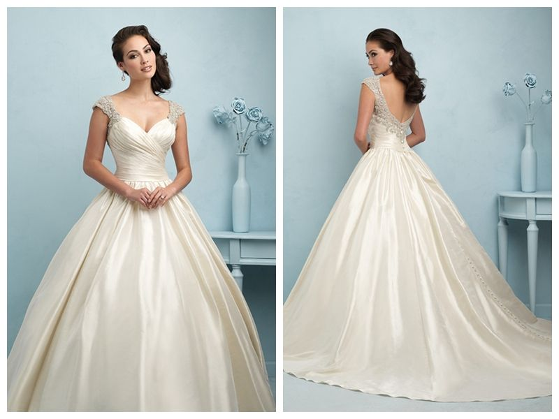 The Backless Sweep Gown Is A Ball Gown Style Wedding Dress