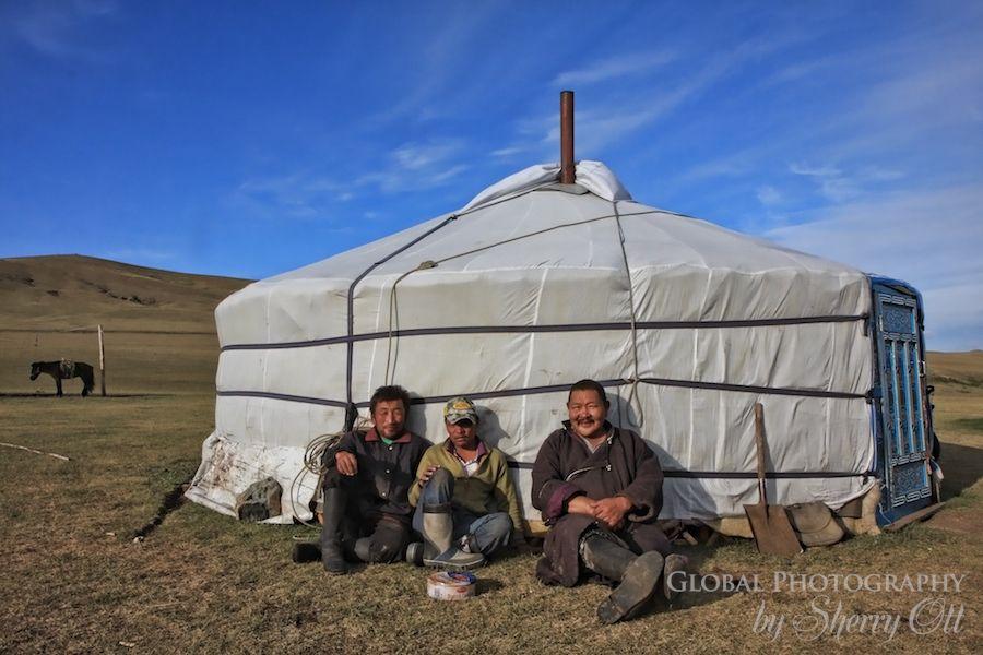 Men relax outside their ger