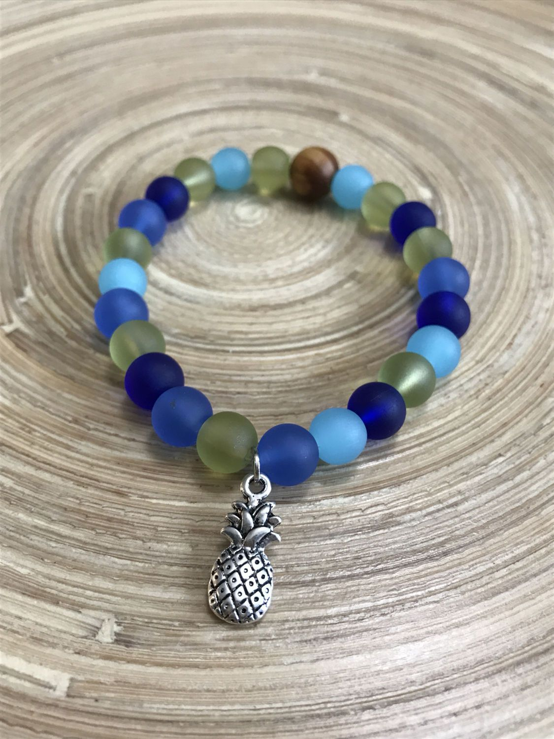 FOLLY Bracelet - sea glass bracelet.  Available charms include #pineapple #anchor #turtle  #handmade #jewelry #bracelet #beaded #seaglass #beachy #silver #gold