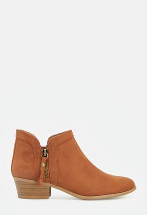 d0f3f2b74 A super chic and modern boot featuring a faux stacked block heel, inner zip  closure, and strap and buckle details.