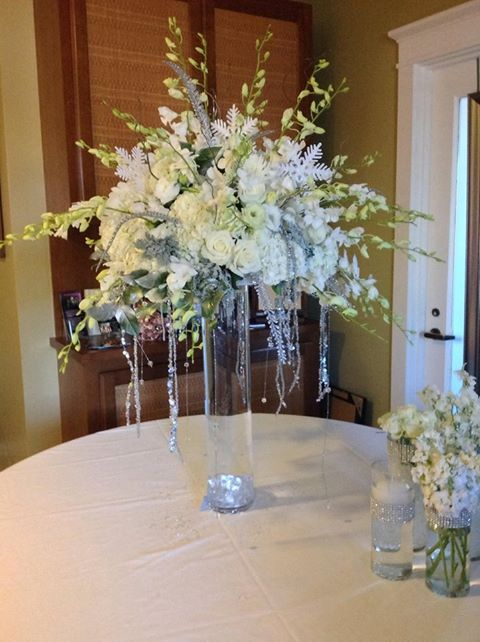Winter wonderland centerpiece of white dendrobium orchids