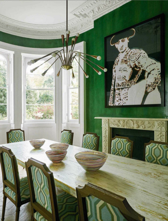 A Dining Room With Kelly Green Walls Chairs Upholstered In Slightly Geometric Colorway