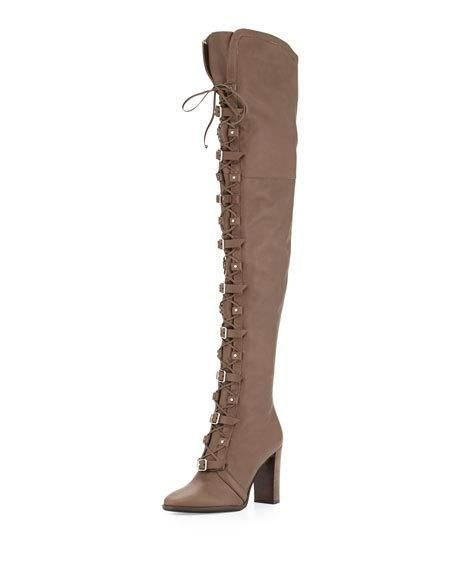 """Jimmy Choo leather moto-style over-the-knee boot. 3.8"""" stacked block heel; 24.5""""H shaft; 16"""" circ. Round toe. Lace-up front with buckle straps. Gored inset at leg opening. Side zip eases dress. Padded"""