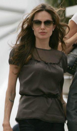 0775976aac Angelina Jolie in Oliver Peoples  Strummer