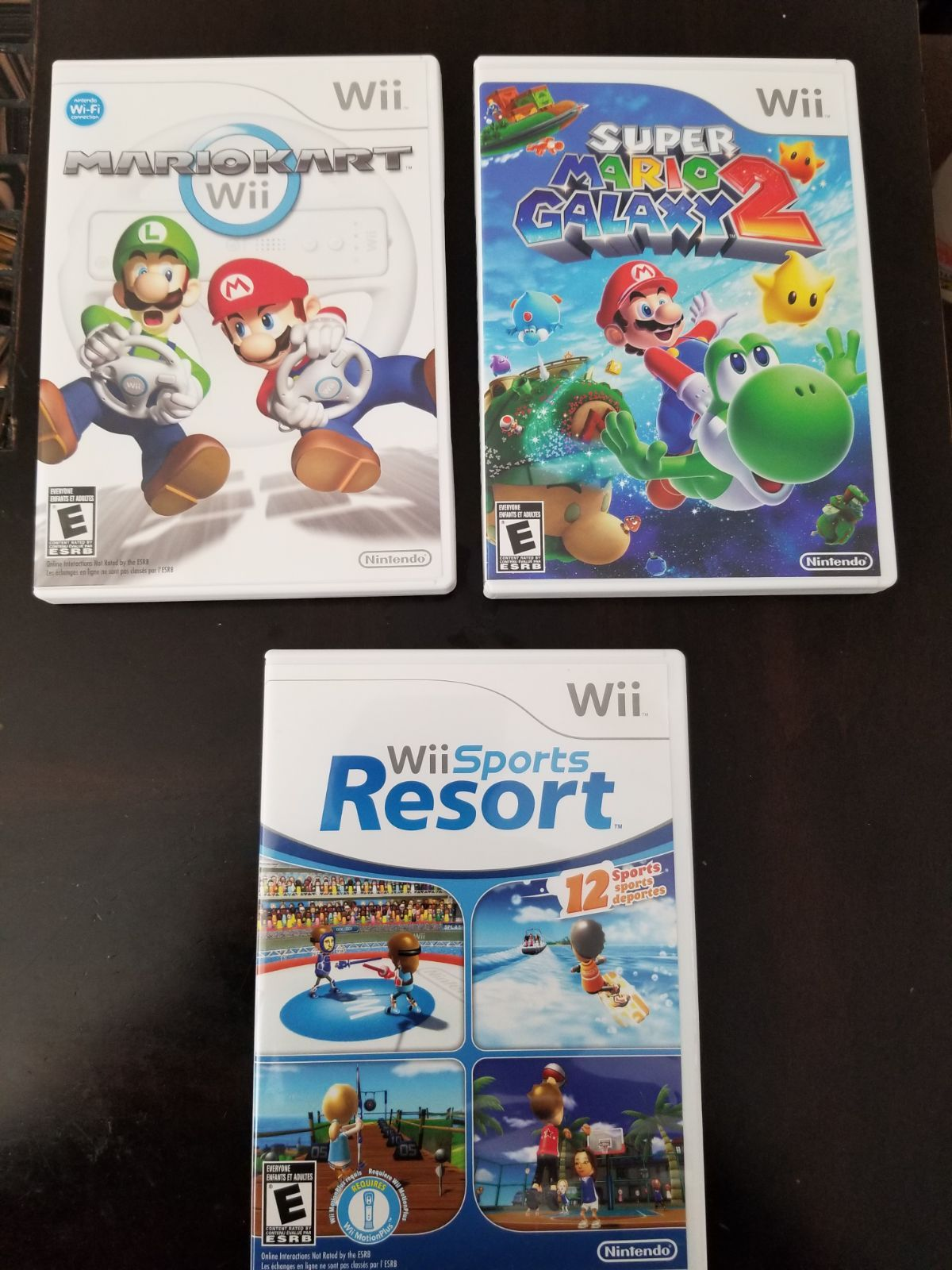Nintendo Wii Game Lot Of 3 Mariokart, Wii Sports Resort