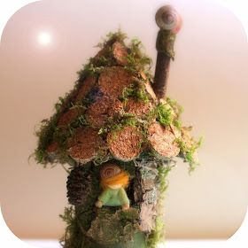 Our latest fairy house is made of a toiletpaper roll, sturdy paper and cork!   I'm very happy with the result because it is made of rec...