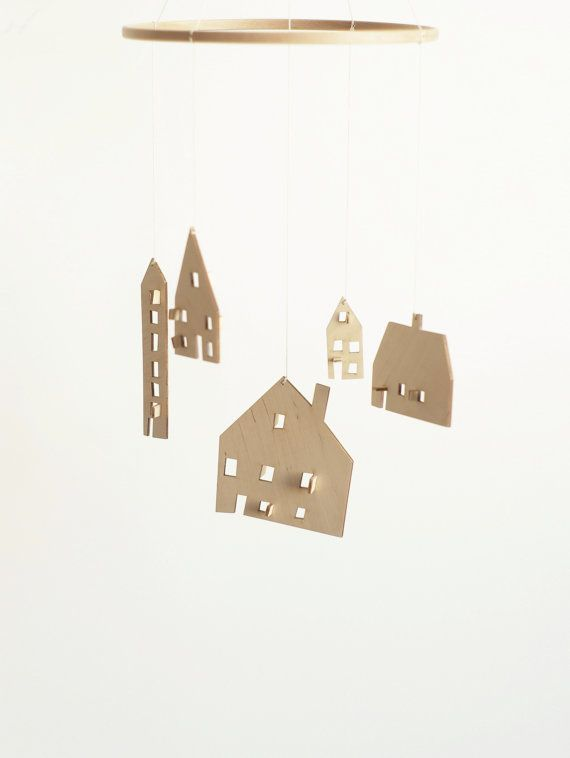 this wooden house mobile is made by the drawing of my 10 year sonthis wooden house mobile is made by the drawing of my 10 year son houses are laser cut from natural wood veneer, unpainted it would be wonderful gift
