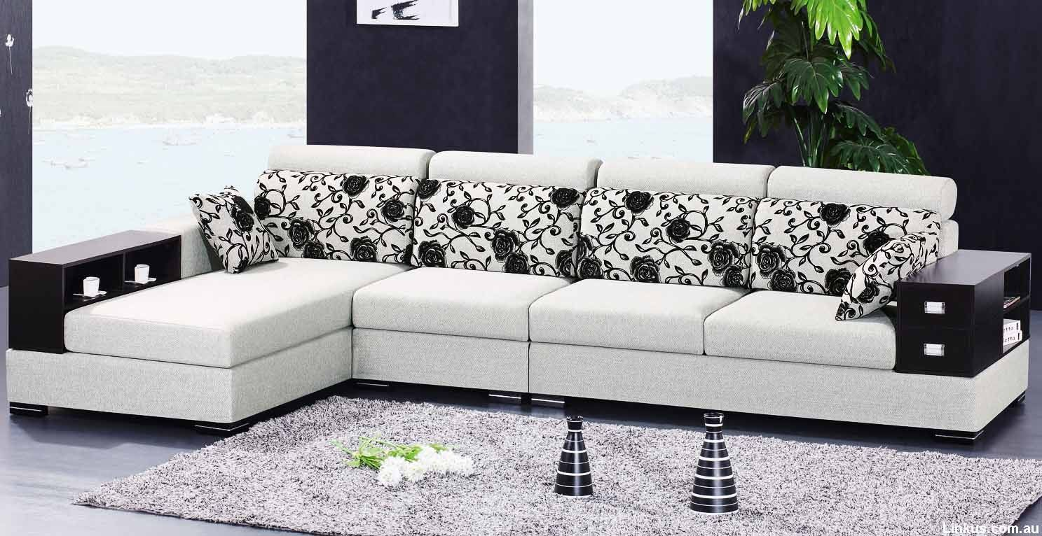 White L Shaped Sofa With Floral Patterns Of Cushions Also Grey Soft Carpet Black Sidetable Houseplant L Shaped Corner Sofa Design Sofa Set Designs Sofa Design