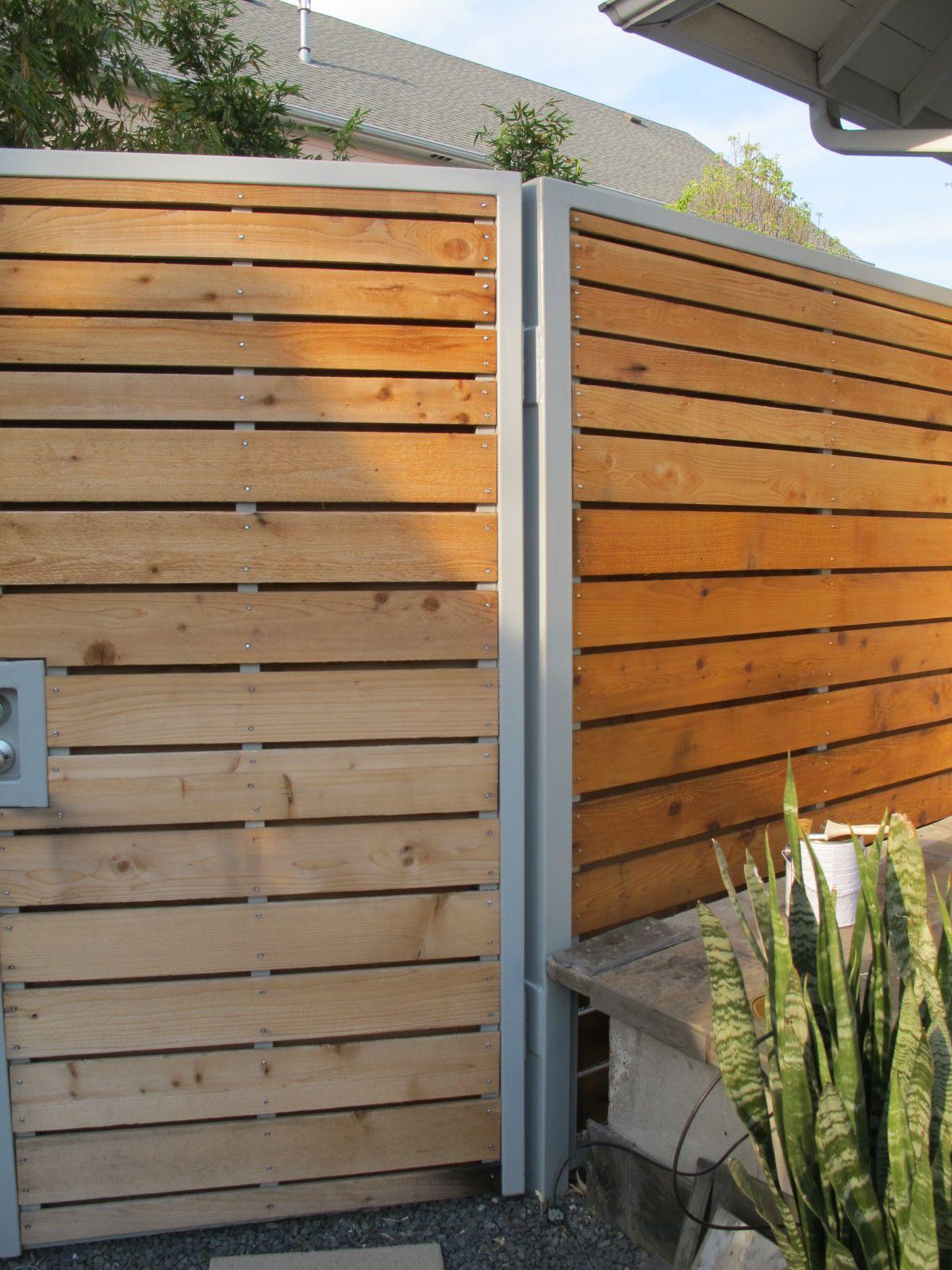 modern cedar/steel (or powdercoated aluminum?) fence