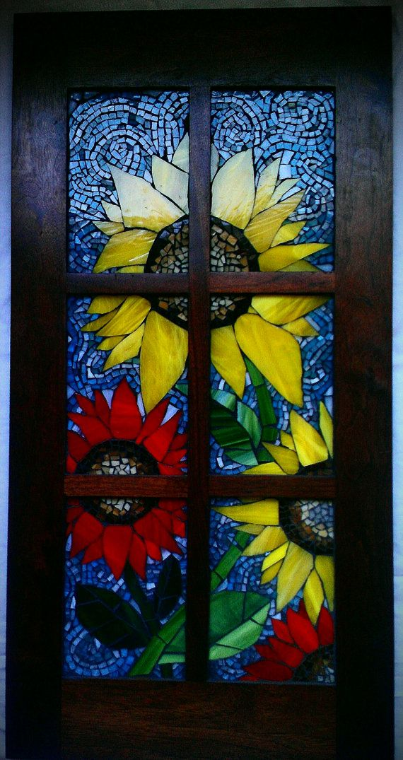 This is a beautiful piece that has taken me many hours to complete. In addition to the large pieces of stain glass, this piece also contains many
