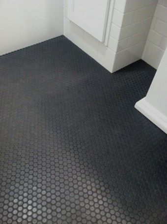 All White Bathroom With Round Black Floor Tile Ann Sacks Savoy Penny Mosaics Remodelista Best Bathroom Flooring Shower Floor Tile Penny Tiles Bathroom