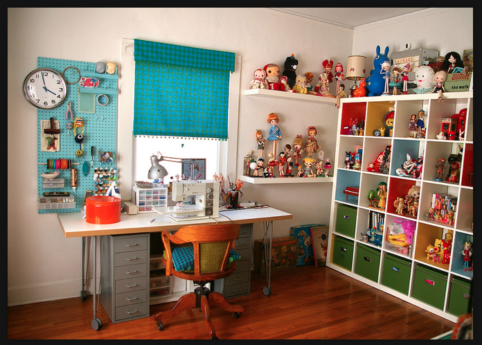 Ultimate craft room and study. Bright colours, plenty of room for display, practical and clean.