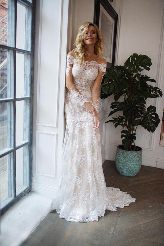 Photo of off the shoulder wedding dress,  Nektaria   long sleeve lace wedding dress
