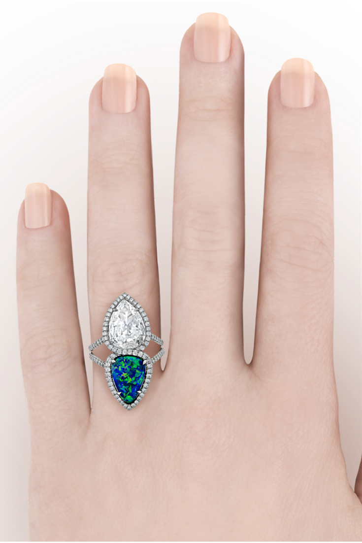 Two rare pear-shaped gemstones are the stars of this twin stone ring ...