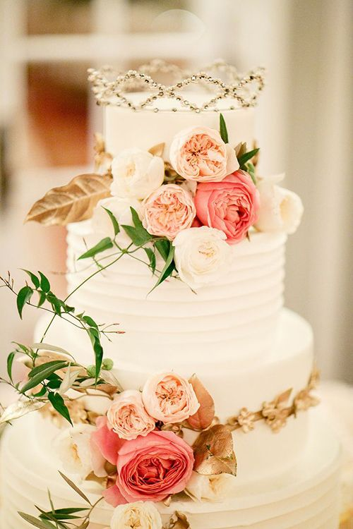 A White Wedding Cake With Fresh Flowers Topped The Brides Grandmothers Crown
