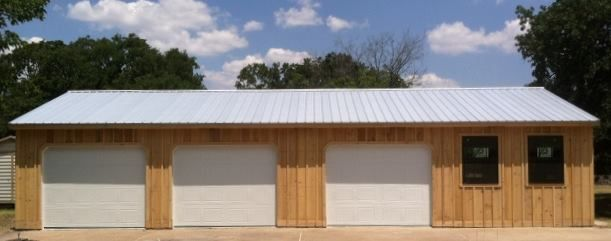 24x48 prefab garage. Pine board and batten siding with